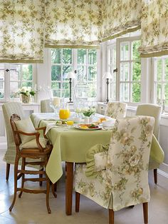 Pretty breakfast room....love the restrained floral design of the fabric