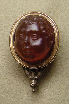 Head of a little boy Date: first half 16th century Culture: probably Italian, Venice Medium: Carnelian and gold Dimensions: Overall: 1 1/8 x 11/16 in. (2.8 x 1.8 cm); visible cameo: 16.8 x 13 x 10.9