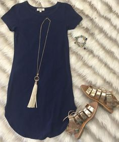The Fun in the Sun Tunic Dress in Navy is comfy, fitted, and oh so fabulous! A great basic that can be dressed up or down! Sizing: Small: 0-3 Medium: 5-7 Large: 9-11 True to Size with a Stretchy, Fitt