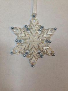 Handmade Beaded Snowflake Ornament featuring White AVA beads Size 11 Silver Japanese Delica beads Czech Fire Polished Crystal beads Swarovski Light Blue Crystal Pearls Measures approximately across Beaded Christmas Ornaments, Snowflake Ornaments, Snowflakes, Christmas Crafts, Christmas Decorations, Christmas Balls, Bead Crafts, Jewelry Crafts, Beaded Ornament Covers