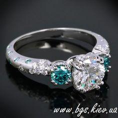 http://bgs.kiev.ua/obruchalnye-koltsa-s-chernymi-brilliantami Помолвочное кольцо из белого золота с бриллиантами и сапфирами