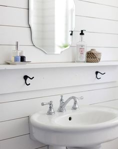 a slim ledge or trim right between your sink and mirror. This sweet alternative to a wide vanity top is a super-easy install and provides a perfect resting place for small necessities and accessories, like your hand soap, candles, bud vases and the like.