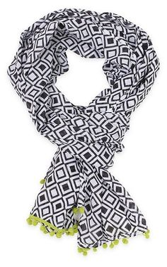 This organic-cotton scarf comes in a graphic print and features a playful pom-pom finish. Light weight scarf. Perfect for any season or any outfit! www.thepreppypair.com