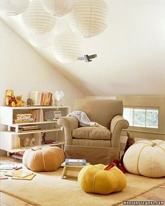 Quiet corner of an attic. I like the big chair, the lanterns, and the squishy pumpkin pillows. :)