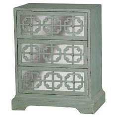 """Showcasing mirrored panels and a latticed overlay, this 3-drawer chest is a perfect addition to your master suite or guest room. Product: ChestConstruction Material: Wood and mirrored glassColor: Grey and silver  Features: Button-pull hardwareLattice overlayThree wallpaper lined drawersMirrored panels54.46 lbsDimensions: 34"""" H x 36"""" W x 12"""" D  Assembly: Assembly required - hardware included"""