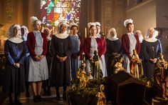 The sisters of Nonnatus House at a church service in Call the Midwife