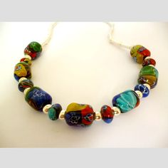 Millefiori Glass and Sterling Silver Beads by CrystalClarkeJewelry #etsy #millefiorinecklace #silvernecklace #beadjewellery #handmadejewellery