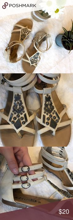 Strappy Gladiator Sandals, Ankle Strap Shoes Gladiator style sandals! 3 ankle straps on each foot - adjustable tightness. Metallic embellishments. Zippers on the back of the ankles. Light tan/cream straps. Darker tan/brown bottoms. Slight wear as shown, but over all in great condition! Shoes Sandals