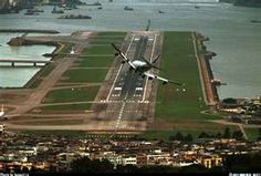 Kai Tak runway...on landing you'd have a chance to land in the ocean and on take-off flying into a mountain