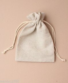 PACK-OF-12-NATURAL-IVORY-LINEN-DRAWSTRING-BAG-POUCH-GIFT-JEWELLERY-WHOLESALE