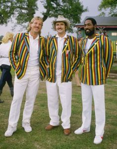 Two future knights, one wannabe Lord: Ian Botham, Tim Hudson and Viv Richards show off the garish blazers, marketed as Hudson's Hardware, that were briefly all the rage in 1985 © Getty Images