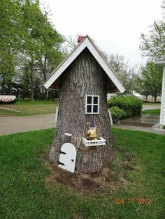 Gnome house out of tree stump.  Cute!