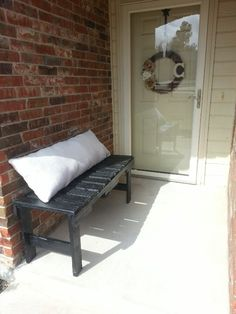 Pallet bench for my small front porch. Going to put the word welcome on the bench pillow soon
