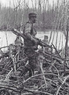 Vietnam era Special Forces--funky camo he's wearing...wonder what the history is behind that pattern.