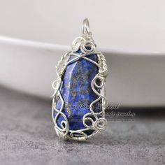Wire wrapped Lapis lazuli pendant necklace Silver wire Natural Lapis necklace Navy blue stone necklace Lapis pendant gemstone Boho jewelry by somethingsepical on Etsy https://www.etsy.com/listing/238292664/wire-wrapped-lapis-lazuli-pendant