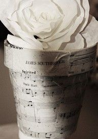 Jason said he'd like to incorporate music in the decorating. Sheet music on flower pot.