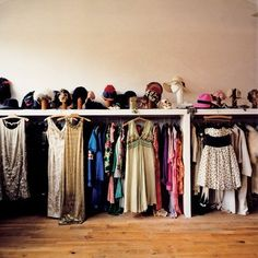 Put all clothes in one place with divider per child and storage space below and above.