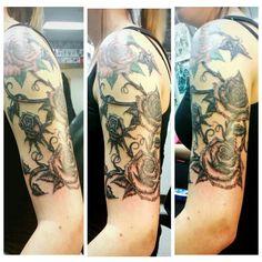 Half sleeve rose tattoo