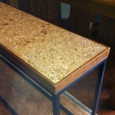 Wood table top. Could use wine corks