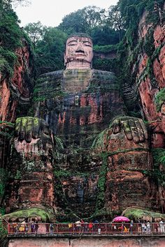 Buddha on Leshan mountain, China --- In 1996, the Mount Emei Scenic Area, including the 'Leshan Giant Buddha' -- the largest stone-carved buddha in the world -- was declared a World Heritage Site by UNESCO. Mount Emei is located within the county-level city of Emeishan, which is under the administrative jurisdiction of Leshan, China