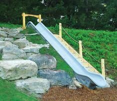 Equip a small hill or slope with this Dual Embankment Slide! Shop Play with a Purpose for all your slides & playground necessities today! Backyard Slide, Sloped Backyard Landscaping, Sloped Yard, Backyard Playground, Backyard For Kids, Landscaping With Rocks, Backyard Projects, Playground Slides, Steep Backyard