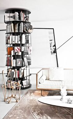 Wow! Circular metal book storage. I wonder if it spins? That would make this incredible bookcase even more versatile as you could also utilise cornerspace.