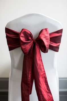 Red Taffeta chair cover sash.