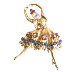 Gold Diamond and Gemstone Dancer Brooch | From a unique collection of vintage brooches at https://www.1stdibs.com/jewelry/brooches/brooches/