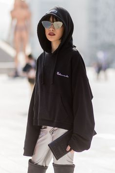 The Best Street Style From Seoul Fashion Week #refinery29 http://www.refinery29.uk/2016/10/126995/street-style-seoul-fashion-week#slide-13 Forget the Vetements hoodie, we're more focused on those silver trousers and over-the-knee boots....
