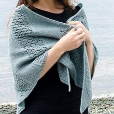 """The body of the lace is garter stitch with bands of lattice lace. Its quick to knit and attractive! Finished Measurements: 64"""" wingspan; 32½"""" deep. Free knitting pattern. Pattern category: Shawls. Fingering weight yarn. 900-1200 yards. Features: Lace pattern. Intermediate difficulty level."""