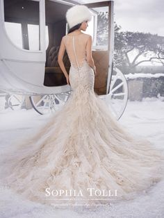 """Sophia Tolli - Y21502 – Blake - Misty tulle wedding dress with ruffles and hand-beading, fit and flare gown with illusion tulle slight cap sleeves,V-neckline that conceals a satin sweetheart bodice, sheer tulle back with plunging neckline framed with lace appliqués,back zipper trimmed with diamante buttons and chapel length train.Also available with a 3"""" raised back neckline as Y21502HB.Sizes: 0 – 28Colors: Blush/Ivory, Ivory, White"""