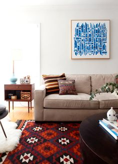 """I like this modern, Danish, living room with """"native"""" influences but I don't like the art."""