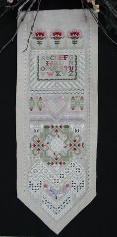 I did this piece by Emie Bishop and although it looks difficult it went by very fast and it is a good learning pattern for intermediate level stitchers.
