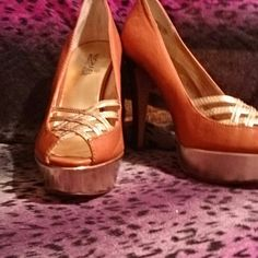 NWOT  Michael Kors Lana MK Lana pumps. Only used as display shoes.Brown leather platform pumps with gold platform accent and lattice peep toe. No box Some closet wear from being moved around. MICHAEL Michael Kors Shoes