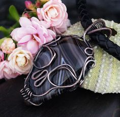 A unique, handmade, wire wrapped skull pendant with Agate Pendant was made by Me, using an extremely labor-intensive and precise wire-wrapping technique, with copper wire. Strongly oxidized and polished to emphasize the braid tangles. It comes with a black leather strap (20.47 inches long). Dimensions of pendant: length: 4,8 cm 1.88 inch width: 3,1 cm 1.22 inch You receive this unique pendant in jewelry box, so it is ready to be a gift. --------On this auction you buy pendant with 20.47 ...