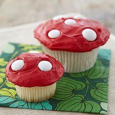 Red frosting and white candies transform homemade cupcakes into whimsical toadstools.
