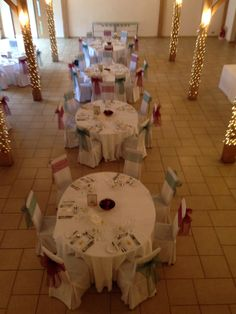 Chair covers with merlot & emerald green sashes at Rivervale Barn ideal for an Autumn or Christmas Wedding by Fuschia.