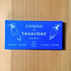 Teuscher 55 at first blush tastes like coconut & powdered sugar, maybe a hint of walnut. A bit of fruit comes out if you really concentrate
