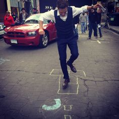 Seamus Dever playing hopscotch on the set of Castle.