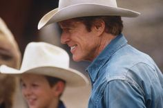"LIVINGSTON, MT - AUGUST 1997: Robert Redford smiles as he watches the round up during the filming of ""The Horse Whisperer"" in 1997. (Photo by John Kelly/Getty Images)"