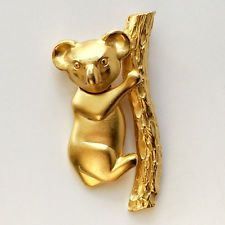 Gold plated satin finish Koala shape with moving body pin brooch, sign... Lot 58