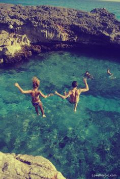jump photography summer ocean water fun couple mountains