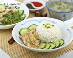 Homemade Hainanese Chicken Rice served with silky smooth poached chicken, thinly sliced cucumber, and garlic chili sauce. It is so simple yet so delicious.