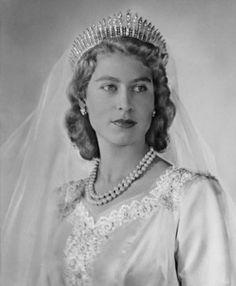 Princess Elizabeth as a bride ... a vision in fringed tiara and Norman Hartnell dress