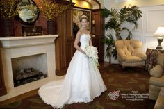 This bride poses in our clubhouse, we love these shots from brides who have their wedding at University Park in Sarasota, Florida! Check out our country club venue, you don't have to be a member to get married here! #UniversityParkWeddings http://www.universitypark-fl.com/weddings/