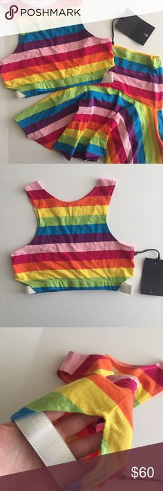 UNIF Iggy striped rainbow skirt & crop top set UNIF Iggy 2 Piece doesn't hide much, so show it off with a pop of color! Your a real wild child in this two piece set that is all sunshine and rainbows with it's multicolored stripes featuring a cropped racer top with a matching high waisted mini skirt.   All the pieces are interchangeable with your wardrobe and will have a bright statement piece! The fabric is made from cotton, it's lightweight and has some stretch, so it's comfortable to wear…