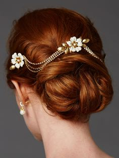 Triple combs enamel bridal headpeice with crystal swags Slide this exclusive statement swag comb set into your bridal updo for a one-of-a-kind wedding day look. With hand-painted enamel floral combs and dramatic drapes of genuine preciosa crystals, this 3-comb gold/ivory wedding headpiece is a sight to behold. Our head-turning headpiece will add runway couture to your bridal look.