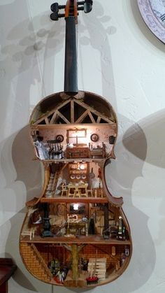 miniature rooms There are sooo many cool things you can do with old wooden instrument bodies. This one is quite the intricate dollhouse out of an old violin. Vitrine Miniature, Miniature Rooms, Miniature Houses, Diy Dollhouse, Dollhouse Miniatures, Dollhouse Design, Victorian Dollhouse, Modern Dollhouse, Fairy Houses