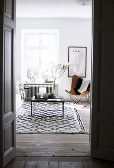 A Swedish Apartment with stunning Beni rug and Leather butterfly chair | DustJacket Attic