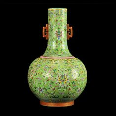 A Chinese porcelain famille rose vase yellow ground, marked, ht. 12 in.